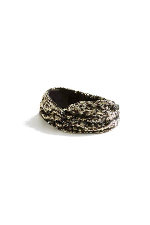 Footwear, Bracelet, Fashion accessory, Beige, Bangle, Headgear, Jewellery, Shoe, Rock, Turban,