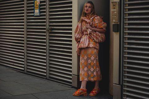 Orange, Clothing, Snapshot, Standing, Street fashion, Fashion, Window covering, Footwear, Window blind, Textile,