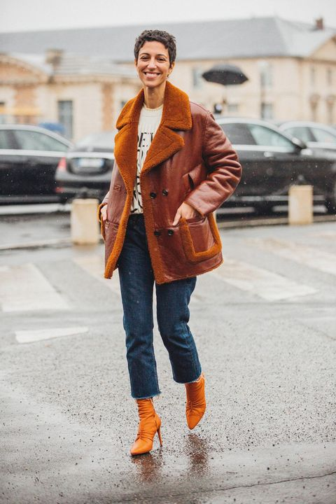 Clothing, Street fashion, Photograph, Orange, Jeans, Fashion, Coat, Snapshot, Outerwear, Fur,