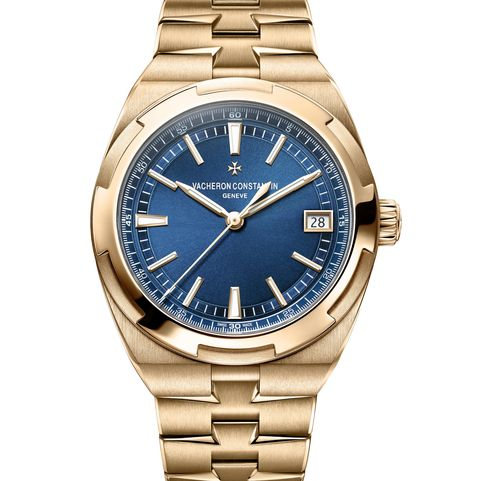 gold sport watch with blue dial