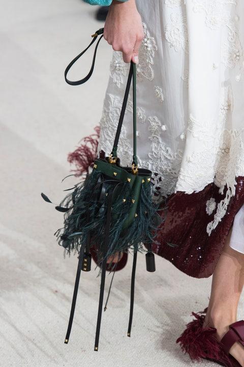 Fashion, Leg, Footwear, Fashion design, Hand, Outerwear, Fur, Dress, Costume, Fashion accessory,