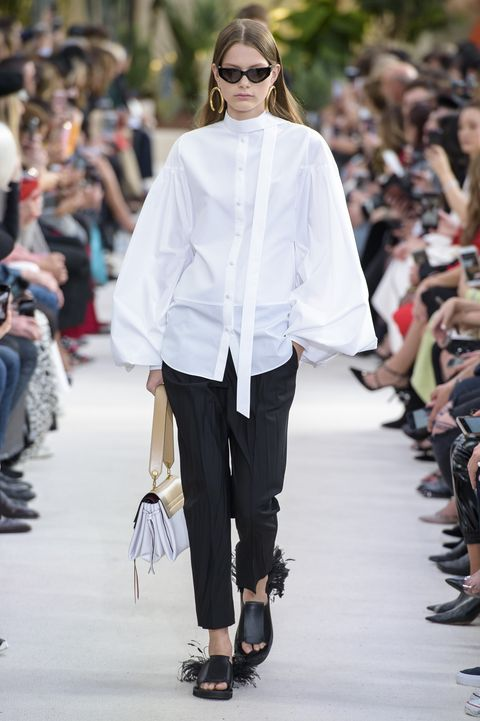 Fashion, Fashion show, Fashion model, Runway, White, Clothing, Street fashion, Shoulder, Eyewear, Outerwear,