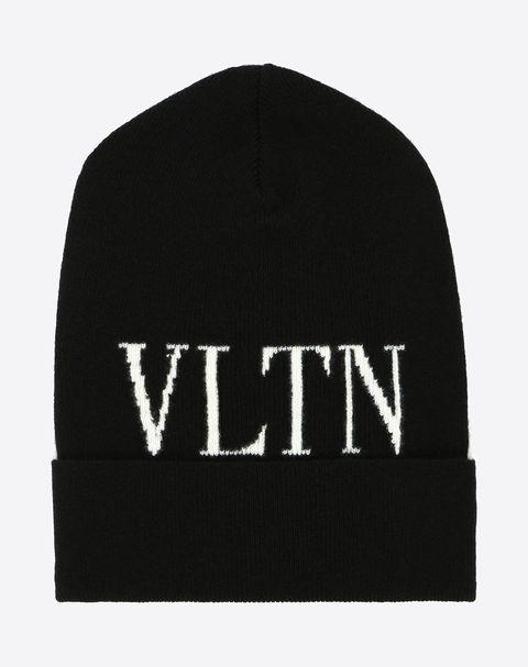 Beanie, Cap, Clothing, Black, Knit cap, Headgear, Font, Logo, Brand, Graphics,
