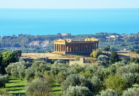 Landmark, Architecture, Sky, Ancient history, Ancient greek temple, Building, Hill, Botany, Tree, Tourism,