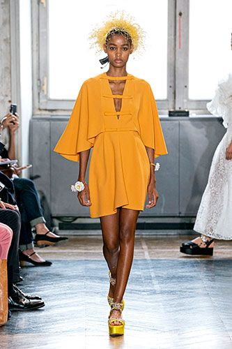 Fashion model, Fashion show, Fashion, Runway, Yellow, Shoulder, Clothing, Orange, Joint, Event,