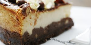 vanilla and chocolate cheesecake with fork
