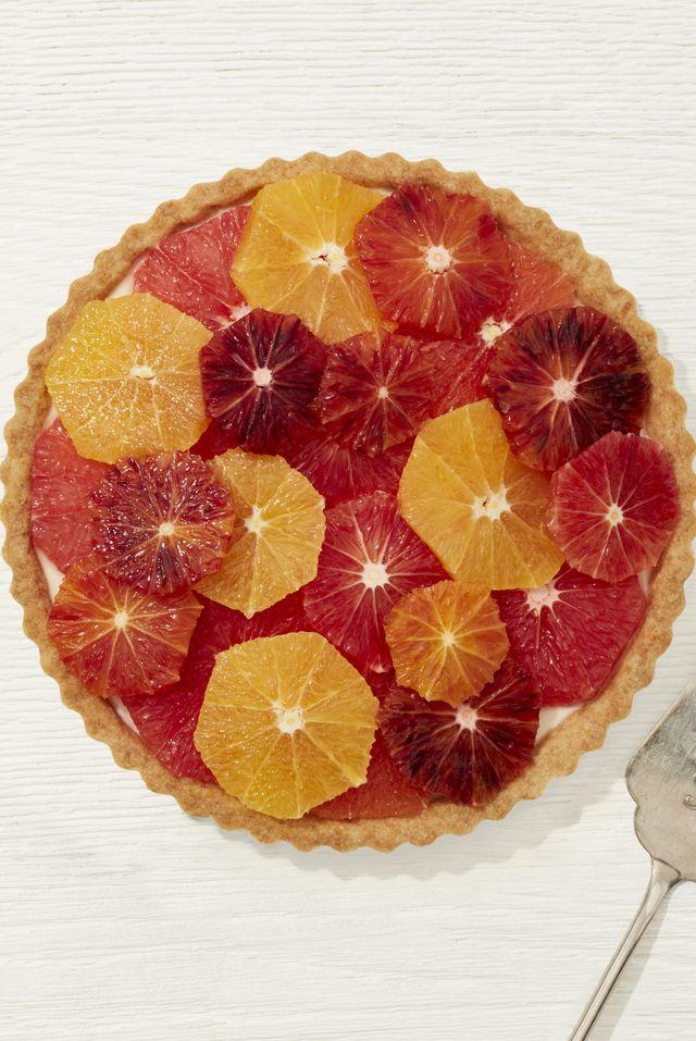 vanilla tart with geometric citrus design on top