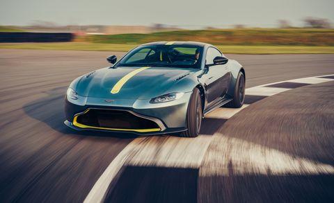 Land vehicle, Vehicle, Car, Sports car, Automotive design, Performance car, Coupé, Supercar, Aston martin v8 vantage (2005), Yellow,