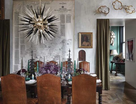 dining area with leather chairs and starburst chandelier