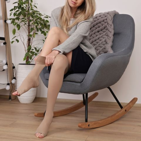 Varicose veins prevention, Compression tights, relief for tired legs. Beautiful long female legs in stockings