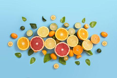 various citrus fruits on blue background