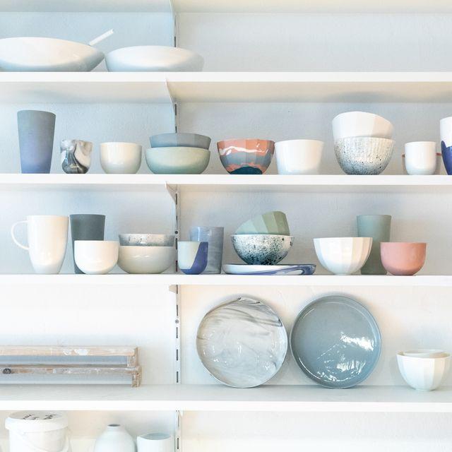 various earthenware on rack in pottery studio