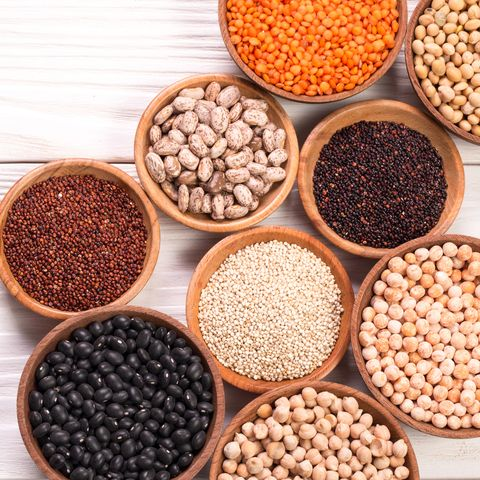 various legumes on wooden background,healthy food,vegan food.
