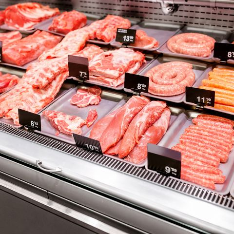 Various sorts of meat on display in shop or supermarket