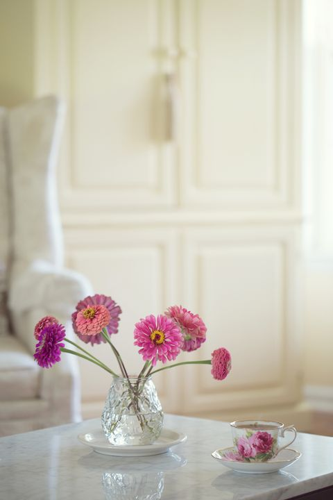 Vase of pink flowers on a coffee table in living room