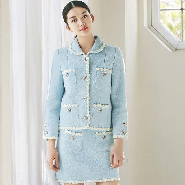 キレイなパステルカラーのジャケットと台形スカートを合わせたツイード素材のセットアップ