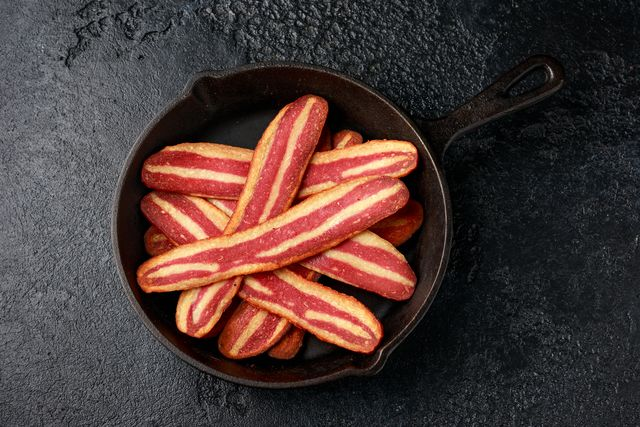 fried crunchy plant based vegan bacon pieces in a cast iron skillet
