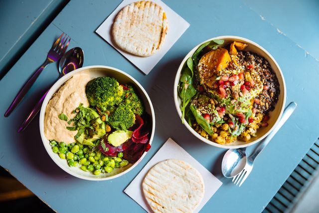 vegan bowls with various vegetables and seeds, high angle view