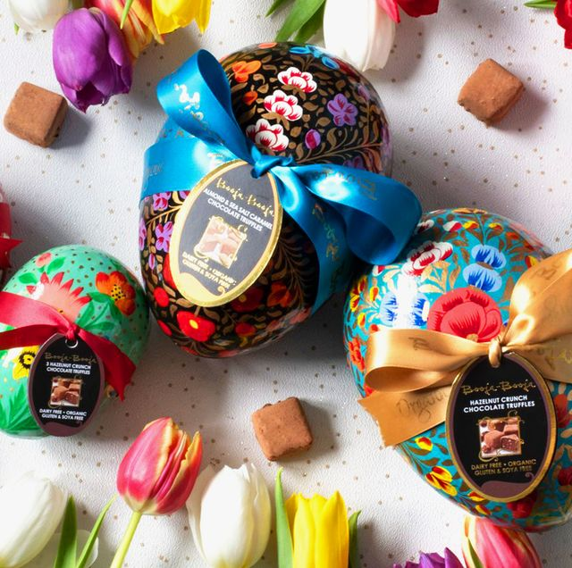Booja-Booja vegan easter eggs wrapped in ribbons surrounded by tulips
