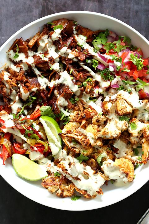 bowl of cauliflour with lime and white sauce