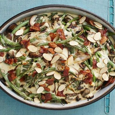green bean mushroom casserole with candied bacon on teal surface
