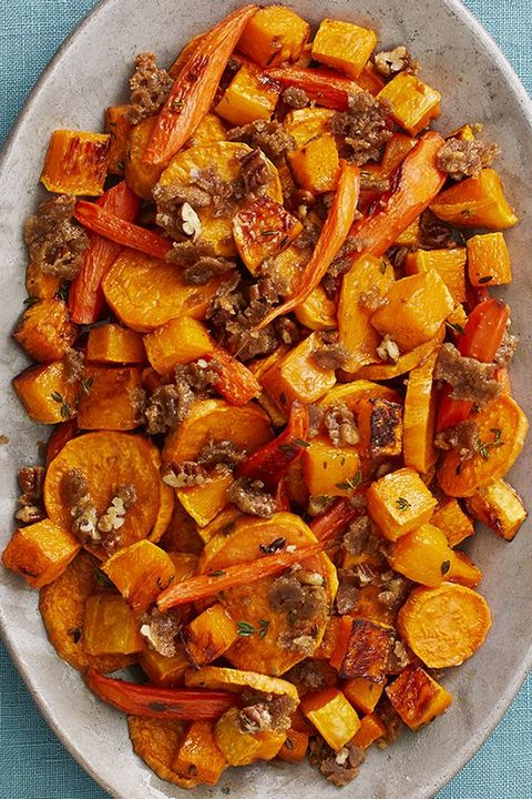 roasted vegetables with pecan crumble on teal surface