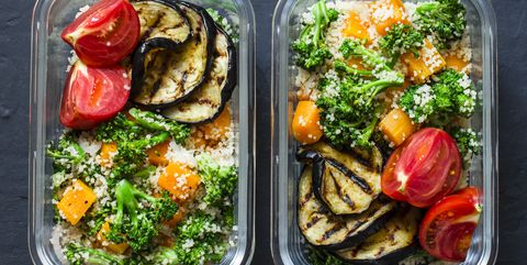 Vegetarian lunch box. Broccoli, pumpkin, couscous salad, grilled eggplant and tomatoes. Healthy diet home food concept. Office food. On dark background, copy space