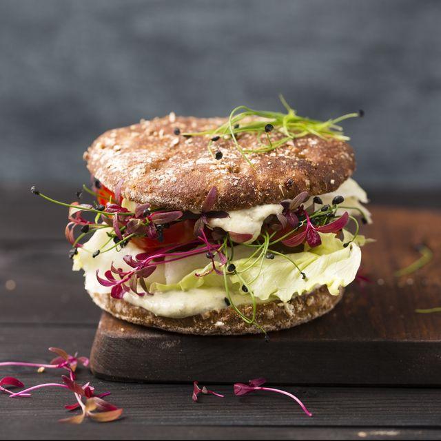 Veggie Burger, vegan, with salad, radish, tomato, rock chive