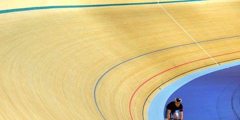 track cyclists riding around a velodrome