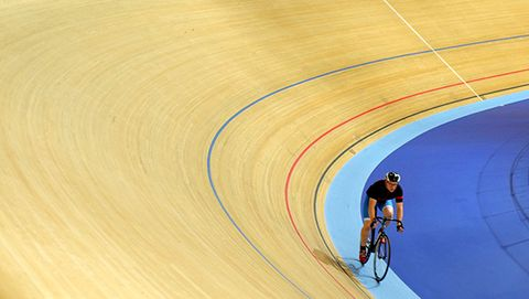 track cyclist riding around a velodrome