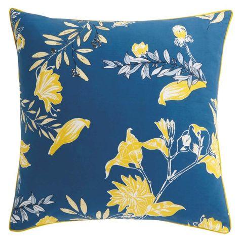 Cojín floral en azul y amarillo