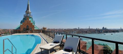Property, Landmark, Real estate, Building, Sky, Tower, Tourism, Vacation, Roof, Swimming pool,