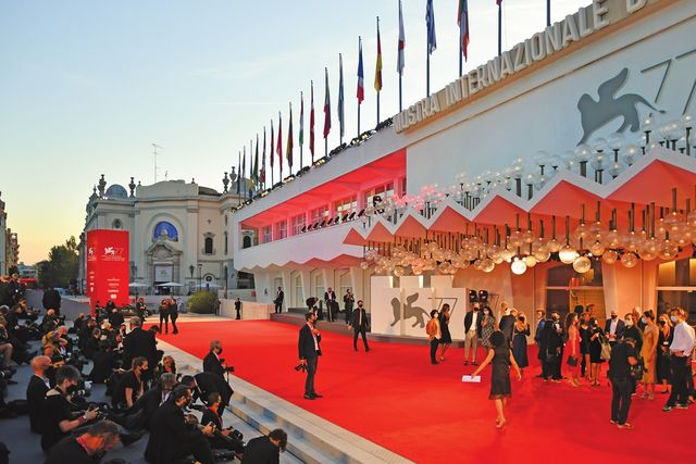 """a general view shows press photographers waiting for guests to arrive at the festival's palace for the screening of the film """"nomadland"""" presented in competition on the tenth day of the 77th venice film festival, on september 11, 2020 at venice lido, during the covid 19 infection, caused by the novel coronavirus photo by alberto pizzoli  afp"""