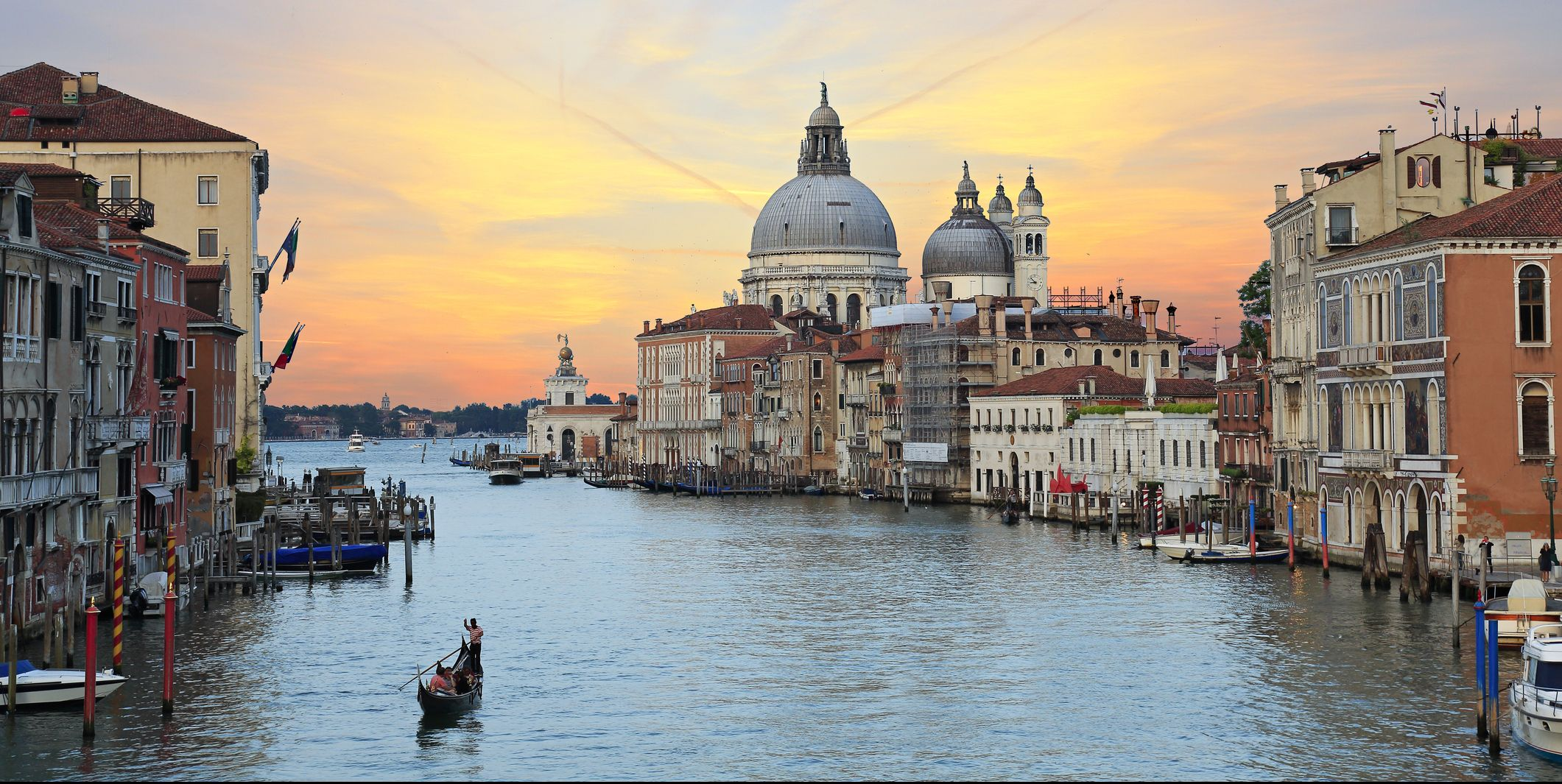 Why is Venice considering a ban on tourists sitting on the ground?
