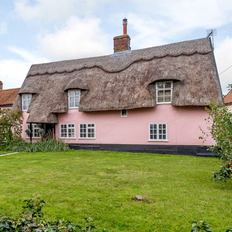 A charming pink thatched cottage, known as Ventura Cottage, is for sale