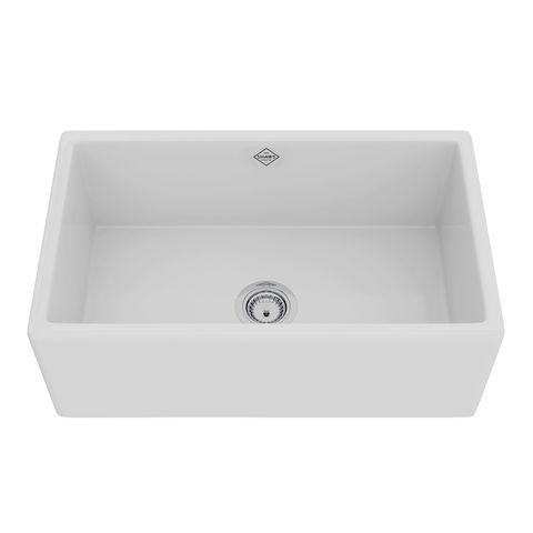 a big oversize white farmhouse sink