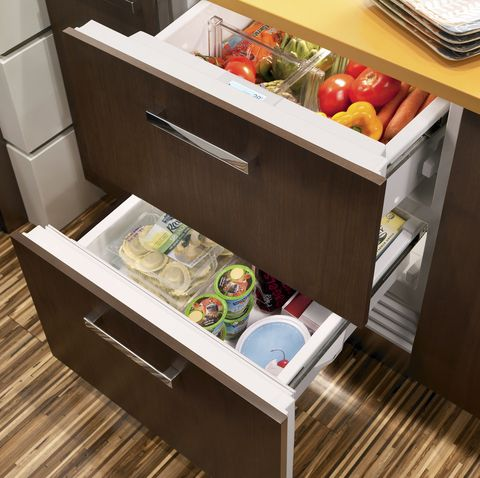 refrigerator and freezer drawers that are nestled under a countertop in a kitchen
