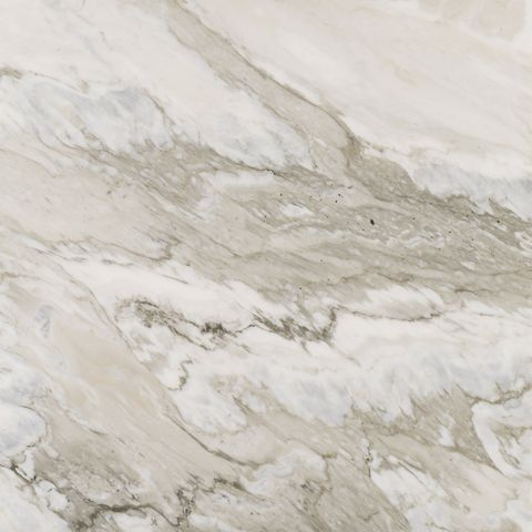 a marble looking tile in creams and tans