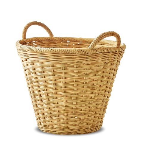 a big laundry basket that is woven