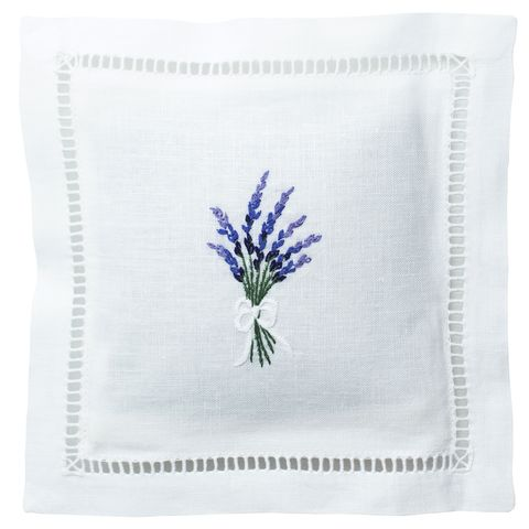 a white linen pouch with a purple sprig of lavender stitched in the middle
