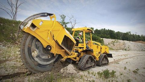 Land vehicle, Vehicle, Construction equipment, Yellow, Bulldozer, Soil, Wheel, Automotive tire, Tree, Tire,