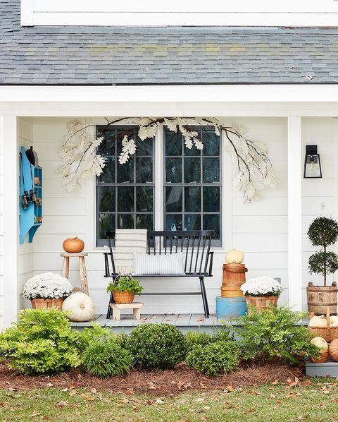 porch with paper crafted garland, white mums and heirloom pumpkins