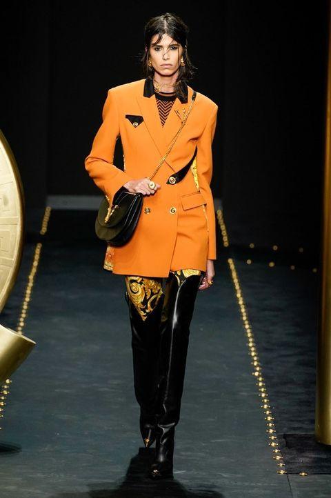 Runway, Fashion model, Fashion, Fashion show, Outerwear, Fashion design, Event, Haute couture, Model, Jacket,