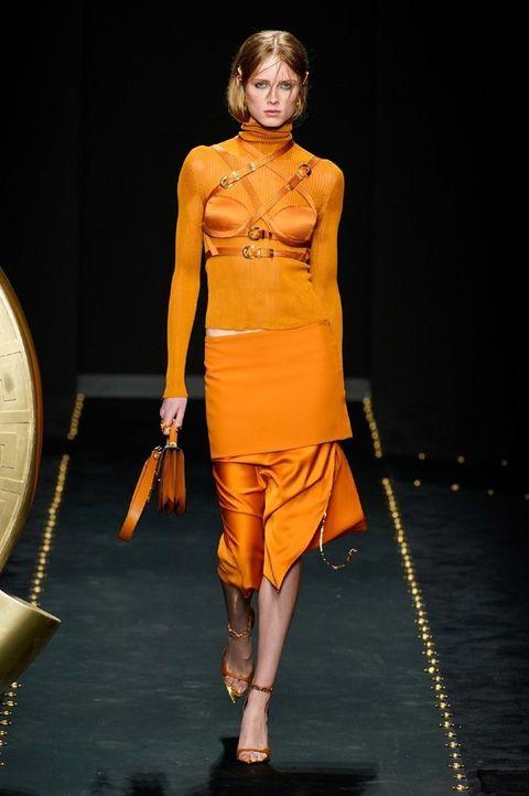 Fashion model, Fashion, Fashion show, Runway, Clothing, Yellow, Fashion design, Shoulder, Orange, Event,
