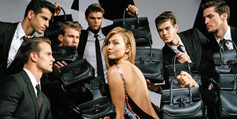 Face, Automotive design, Suit, Tie, Leather, Motorcycle accessories, Motorcycle, Machine,