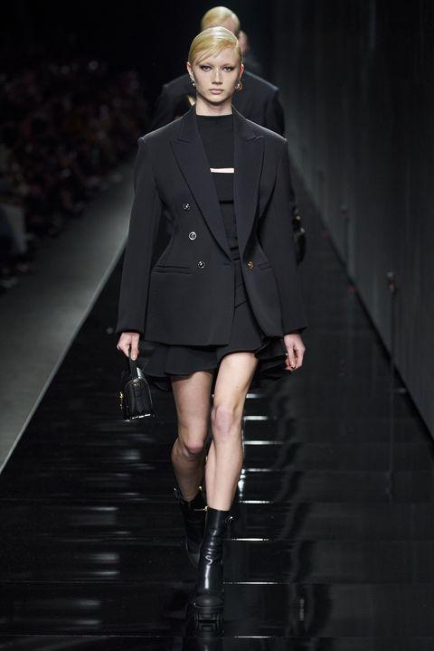 Fashion, Fashion model, Runway, Fashion show, Clothing, Outerwear, Haute couture, Fashion design, Shoulder, Joint,