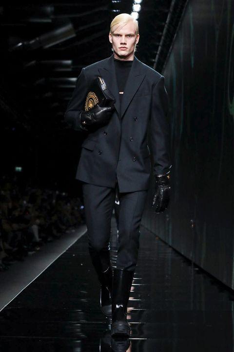 Runway, Fashion, Fashion model, Fashion show, Outerwear, Model, Fashion design, Haute couture, Uniform, Leather,