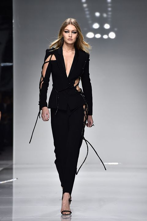 Fashion model, Runway, Fashion, Fashion show, Clothing, Outerwear, Suit, Shoulder, Formal wear, Public event,