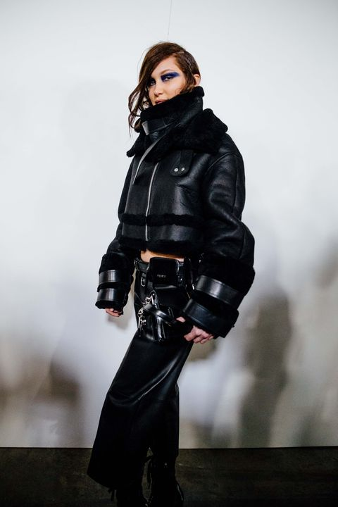 Jacket, Sleeve, Outerwear, Leather jacket, Fashion, Leather, Fashion model, Knee, Knee-high boot, Boot,