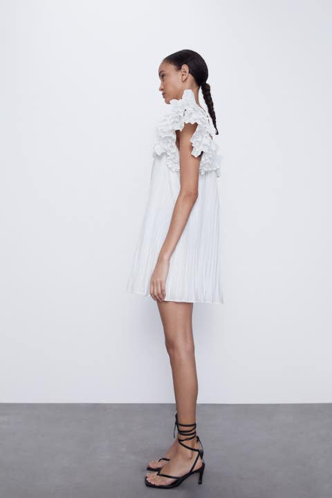 White, Clothing, Shoulder, Fashion model, Dress, Fashion, Footwear, Neck, Joint, Standing,